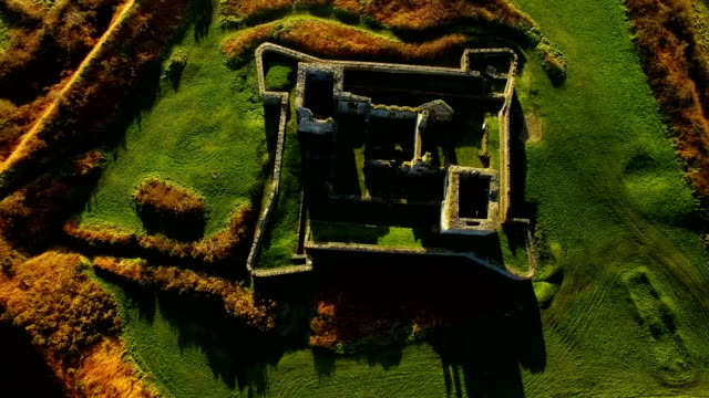 Aerial view of old ruin structure 4k Aerial view of old ruin structure on a sunny day 4k fort stock videos & royalty-free footage