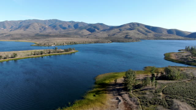 Aerial view of Otay Lake Reservoir with blue sky and mountain