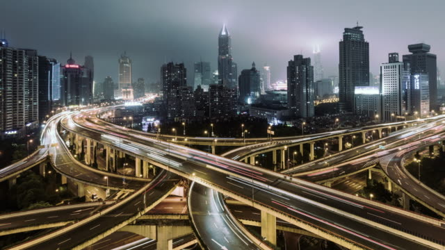 T/L PAN Aerial View of Overpass and City Traffic at Night / Shanghai, China