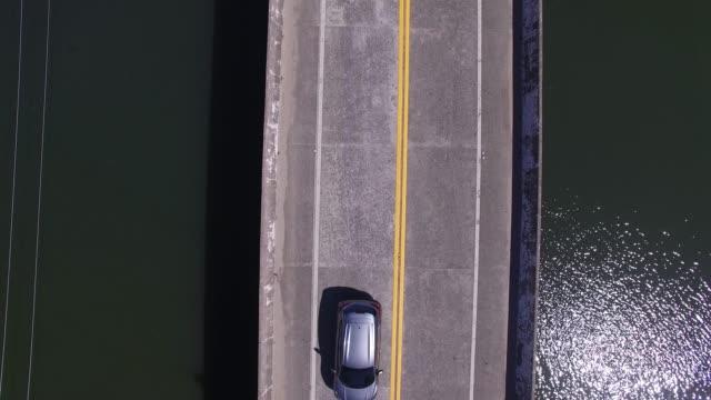 aerial view of overpass bridge in river - пешеходная дорожка путь сообщения стоковые видео и кадры b-roll
