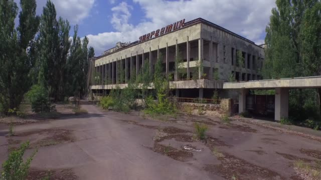 aerial view of palace of culture in pripyat town near chernobyl, ukraine. 4k. - reattore nucleare video stock e b–roll
