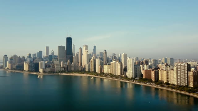 Aerial view of panorama of the city on the shore. Chicago, America on the coast of the Michigan lake on the dawn Beautiful aerial view of panorama of the city on the shore. Chicago, America on the coast of the Michigan lake on the dawn. Scenic view of the downtown near the water. chicago architecture stock videos & royalty-free footage