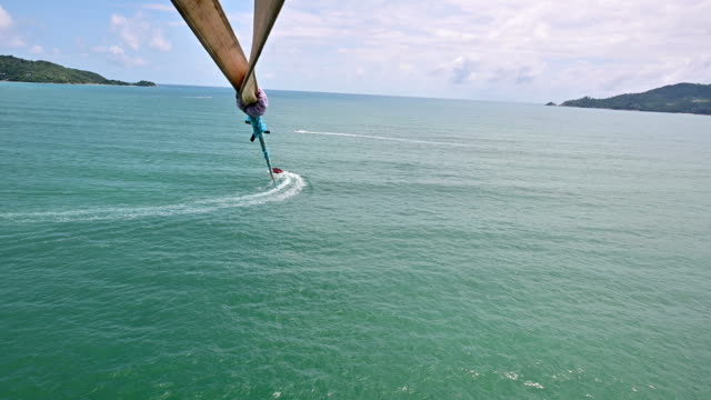 4K Aerial view of parasailing at Patong Beach, Phuket