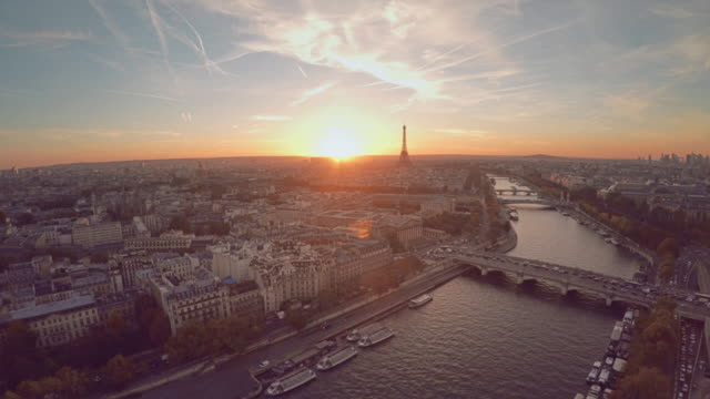 aerial view of paris during sunset - francja filmów i materiałów b-roll