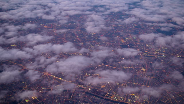 Aerial View of Paris Through Clouds at Sunset video