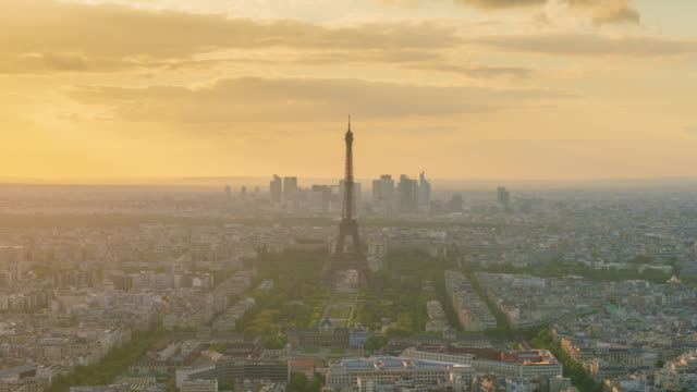 Aerial view of Paris urban skyline at dusk 4k time lapse