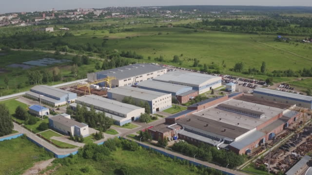 Aerial view of park production plant. Manufacturing area in field drone view. Aerial top down view of modern technology manufacturing factory. Aerial footage of building new large industrial complex video