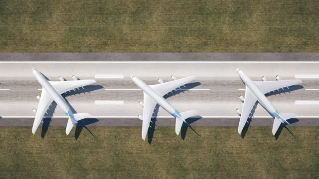 vídeos de stock e filmes b-roll de aerial view of parked airplanes at the airport runway. - covid flight