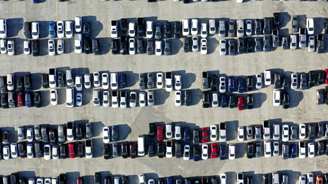 Aerial view of parked cars Aerial view of various parked cars car rental stock videos & royalty-free footage