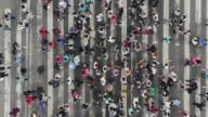 istock Aerial view of pedestrians walking across with crowded traffic 1140364351