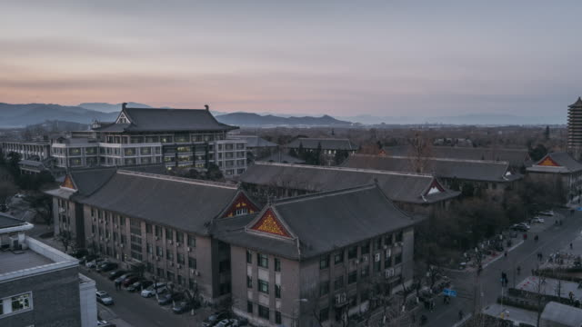 T/L WS HA ZI Aerial View of Peking University Sunset to Dusk / Beijing, China