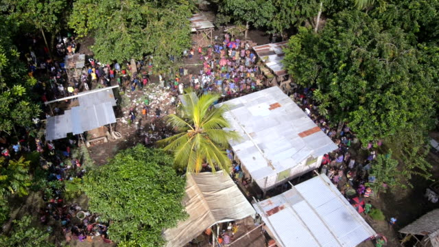 Aerial view of people gathering in the village in Papua New Guinea video