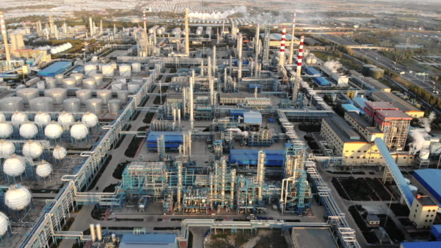 Aerial View of Petrochemical Plant Aerial View of Piping and Tanks of Industrial Factory oil industry stock videos & royalty-free footage