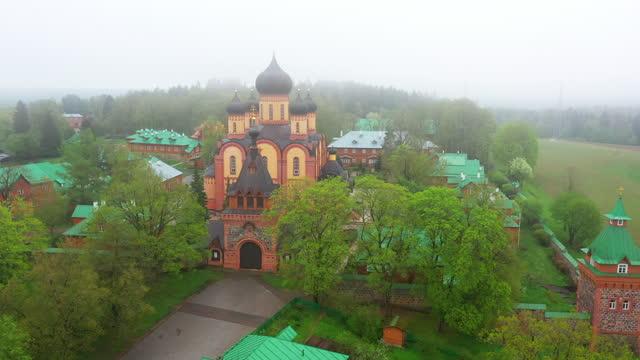 Aerial view of Pühtitsa Convent in Ida-Virumaa, Estonia on a foggy day Kuremäe is largest Orthodox community in the Baltic states. estonia stock videos & royalty-free footage