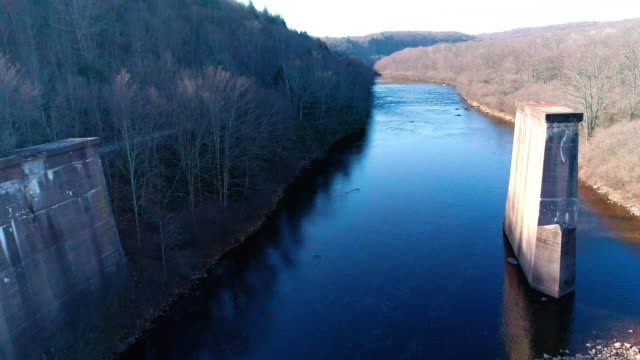 aerial view of pocono mountains, appalachian, in late fall sunny day. the abandoned demolished old bridge over hickory run river - горы поконо стоковые видео и кадры b-roll