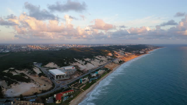 Aerial view of Ponta Negra beach, Rio Grande do Norte, Brazil Aerial wide angle view of the downtown beach in Natal, Ponta Negra beach, at sunrise natal stock videos & royalty-free footage