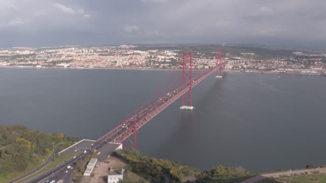 Aerial view of Ponte 25 de Abril Aerial view of Ponte 25 de Abril in Lisbon. ponte 25 de abril stock videos & royalty-free footage