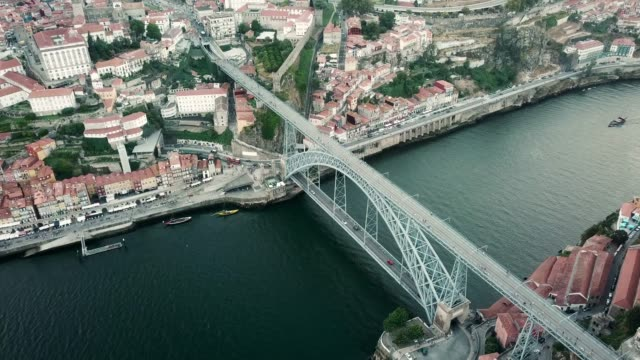 vídeos de stock e filmes b-roll de aerial view of porto, portugal. douro river and luis bridge - douro