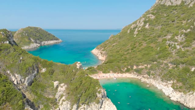 Aerial view of Porto Timoni beach at Afionas is a paradise double beach with crystal clear azure water in Corfu, Ionian island, Greece, Europe