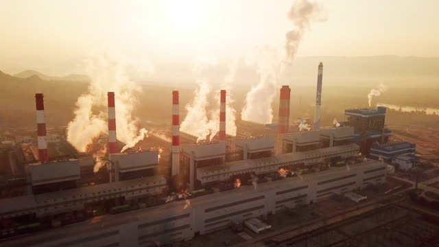Aerial view of Power plant with Smoking chimneys