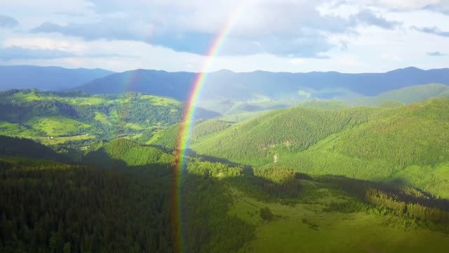 aerial view of rainbow in the mountains