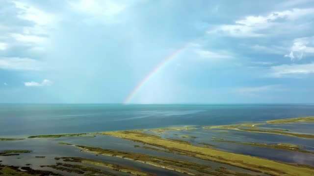 aerial view of rainbow over the sea