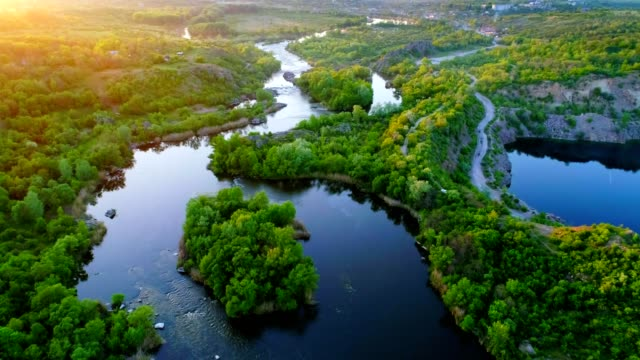 Aerial view of rapid river on sunset video