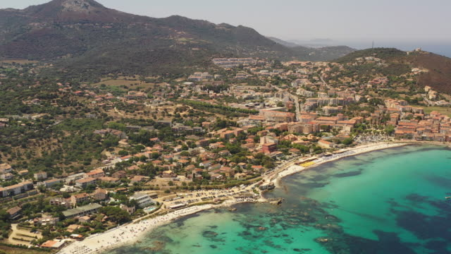 Aerial view of Red Island, Ile-Rousse, Corsica Red Island, port and coastline, Corsica, France