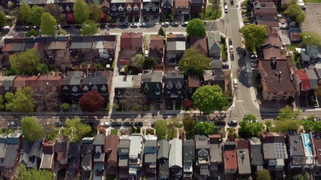 Aerial view of residential homes in late spring. Aerial view of residential homes in late spring. Cinematic 4K establishing shot. residential district stock videos & royalty-free footage