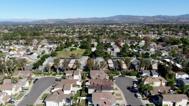 aerial view of residential neighborhood in irvine, california - ocean front properties stock videos & royalty-free footage