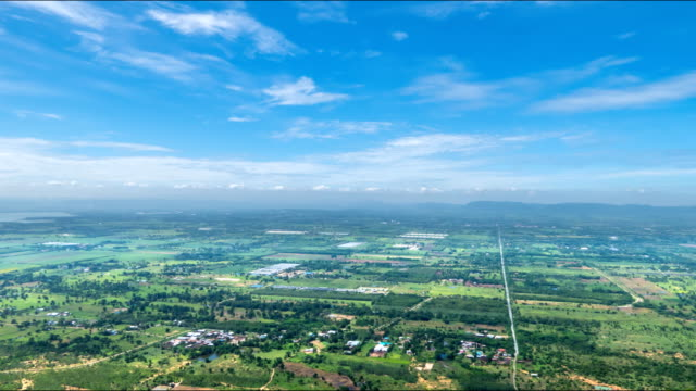 Aerial view of rice fields and pasture in rural. time lapse video