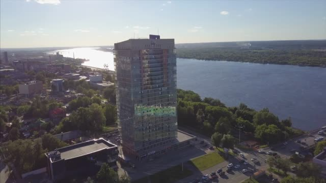 aerial view of river and modern building. clip. beautiful cityscape at the sunset - inghilterra sud orientale video stock e b–roll