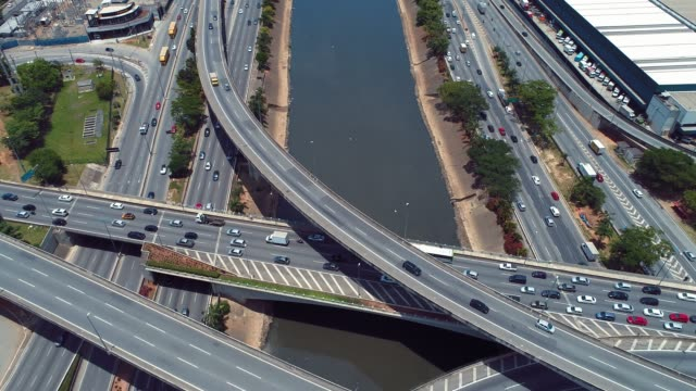 Aerial view of river between roads. Cityscape scenery. Great landscape. Marginal Tietê, São Paulo, Brazil Aerial view of river between roads. Cityscape scenery. Great landscape. Marginal Tietê, São Paulo, Brazil marginal tiete highway stock videos & royalty-free footage