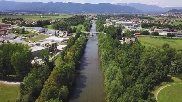 Aerial view of river going trough suburban area