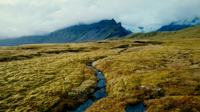 aerial view of river  near  the glacier - nord europeo video stock e b–roll