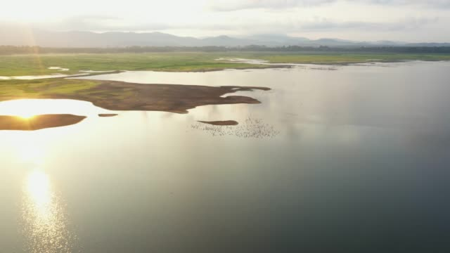 Aerial view of rivers and mountains with beautiful sunshine shining on the water surface. video