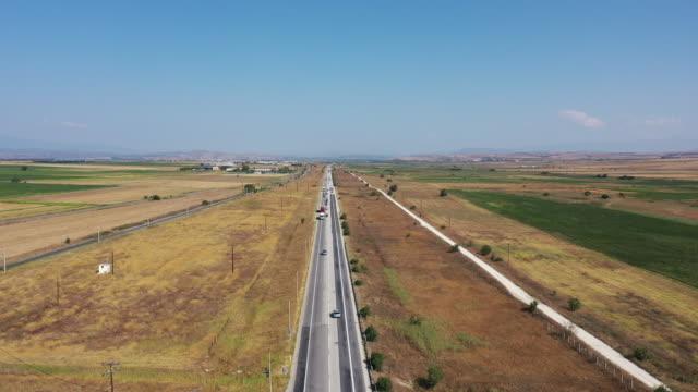 Aerial view of road between fields