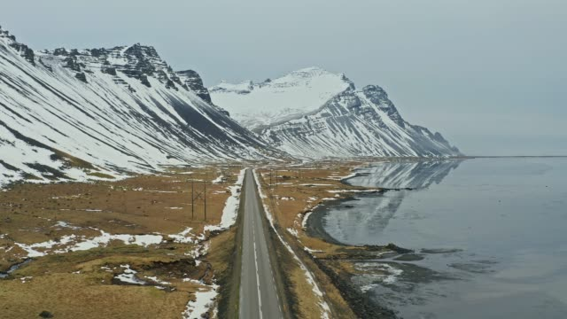 Aerial view of road in Iceland near the sea at winter