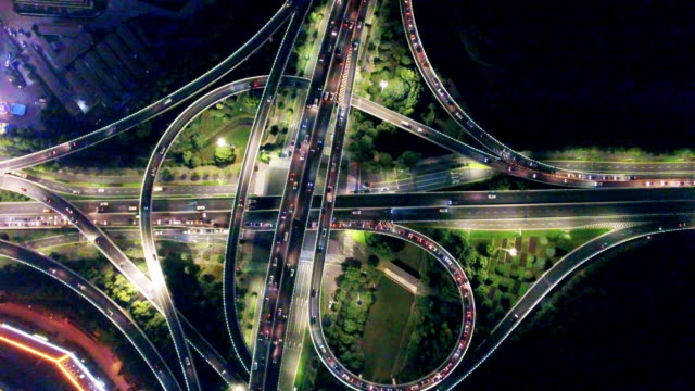 aerial view of road junction in modern city at night video