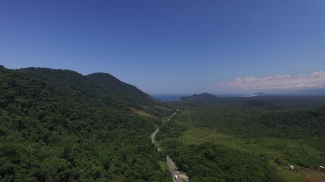 Aerial View of Road Mountains in Rainforest video