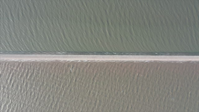 aerial view of road on the sea - dividere video stock e b–roll