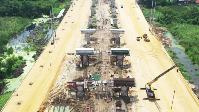 Aerial view of road or highway under construction Aerial view of road  under construction civil engineering stock videos & royalty-free footage