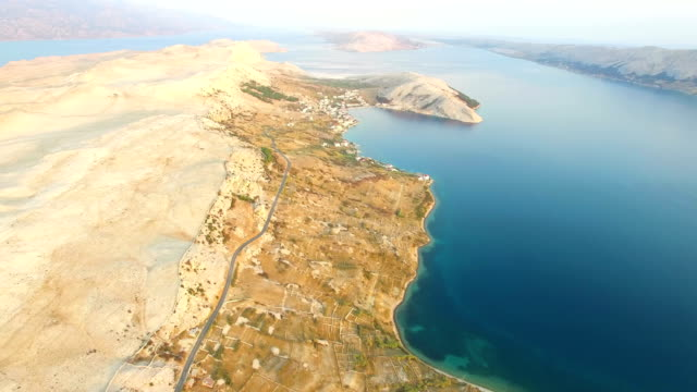 Aerial view of road through barren landscape of Pag island in Croatia video