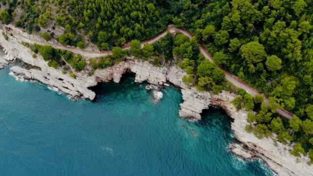 aerial view of rocky shore of adriatic sea - mountain top filmów i materiałów b-roll