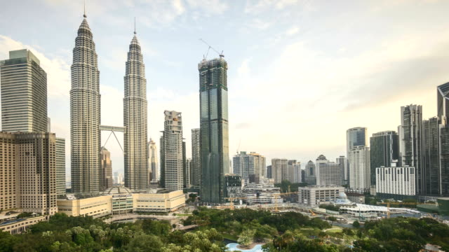 Aerial view of rolling clouds during golden sunrise at Kuala Lumpur city video