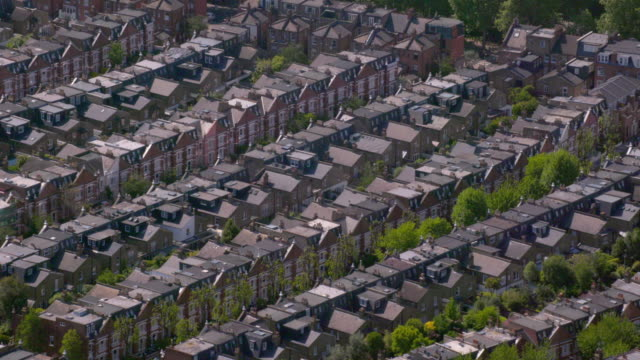Aerial View of Rows of Suburban Victorian Houses in London, UK. 4K An aerial shot of a pretty suburban residential area in west London, UK, featuring Victorian townhouses. Filmed from a helicopter in full 4K in lovely sunshine. 19th century style stock videos & royalty-free footage