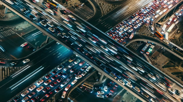 T/L CU HA Aerial View of Rush Hour Traffic on Multiple Highways at Night / Beijing, China Aerial View of Beijing Traffic Jam complexity stock videos & royalty-free footage
