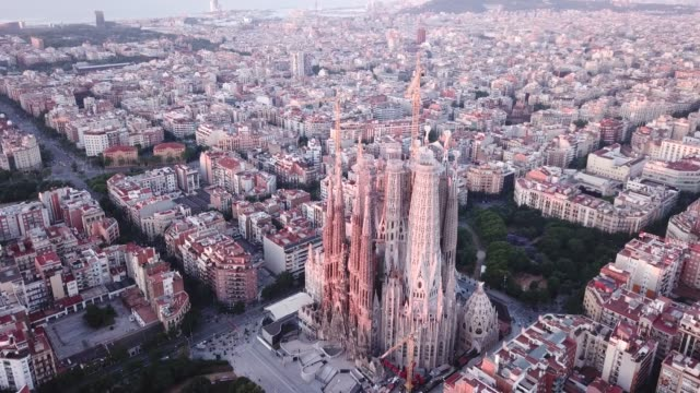 aerial view of sagrada familia at sunrise - gothic architecture stock videos & royalty-free footage