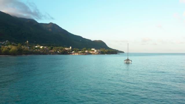 aerial view of sailboat in the ocean. - vivid 4k video stock videos & royalty-free footage