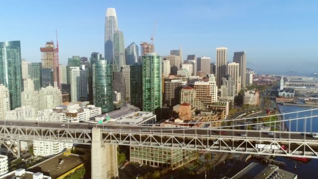 Aerial view of San Francisco city skyline and Bay Bridge at sunrise